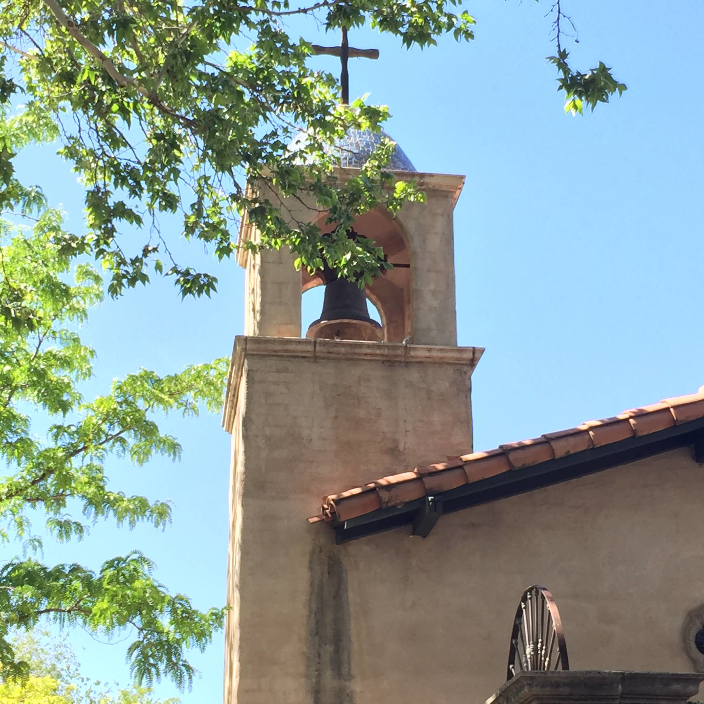 old church with bell and cross